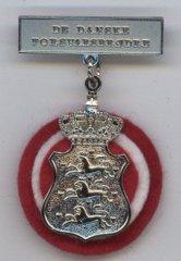 Emblem som bæres af Foreningens medlemmer